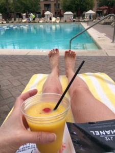 A mango daiquiri and spring fashion mag make for great companion
